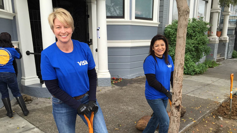 Visa volunteers landscaping in an urban setting.
